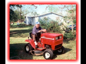 Daddy on his Mower he used as transportation to my house LOL